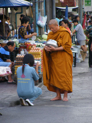 Monk collecting alms 2